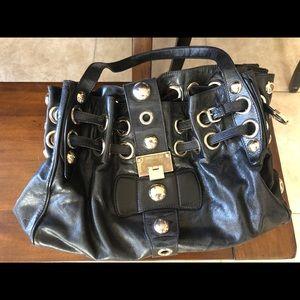 Jimmy Choo Riki Bag in black leather.
